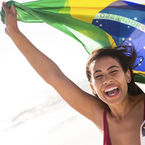 young-brazilian-woman-with-flag-and-football